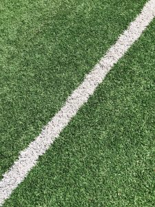 A close-up image of a football pitch